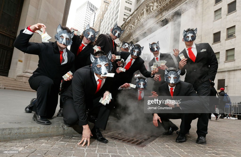 The 'Wolves of Wall Street' pose for a photo at the New York Stock Exchange to mark the 'The Wolf of Wall Street' DVD Release outside of the New York Stock Exchange on March 25, 2014 in New York City.
