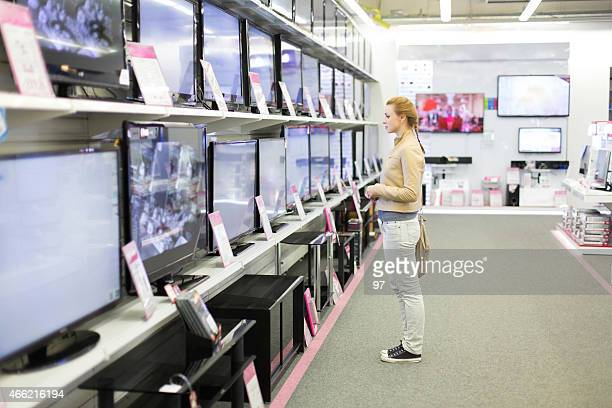 The woman buys a TV in shop
