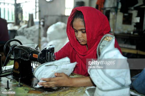 The woman sew Islamic caps in the Alif Cap Garments at Dhaka The Islamic cap is one of the most important things for all Muslims when Ramadan comes...