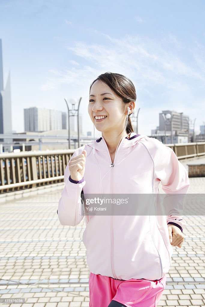 The woman who is running : Stock Photo