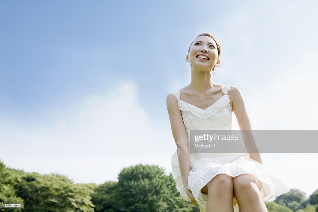 The woman who looks up at the sky comfortably : Stock Photo