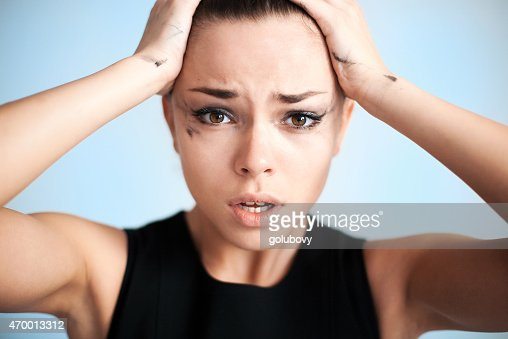 The woman with running mascara : Stock Photo