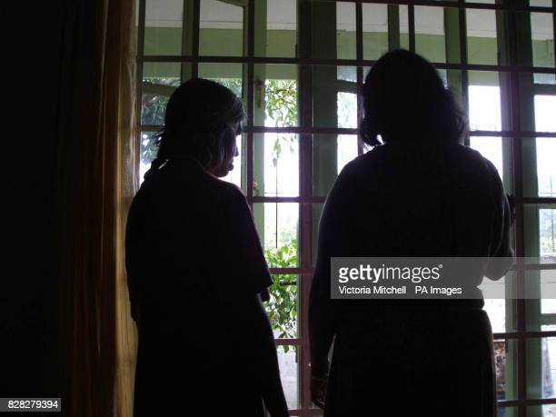 The women look out to the gardens at Netherlee Cottage where women branded mentally ill are being rehoused in the suburbs of Colombo thanks to the...