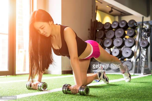 The women making dumbbells at the gym