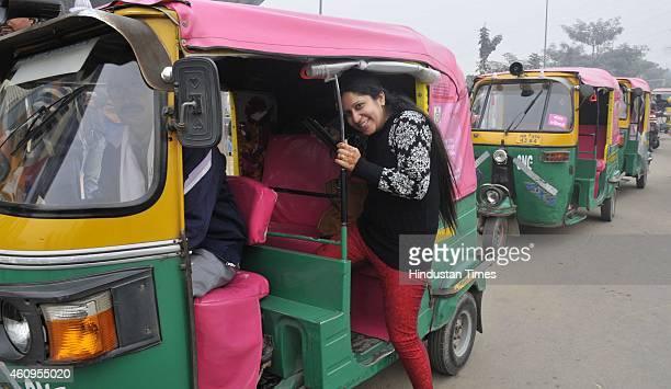 The women passenger were seen boarding the pink auto which is yet to be launched but are ferrying passengers in the city on January 1 2015 in Gurgaon...