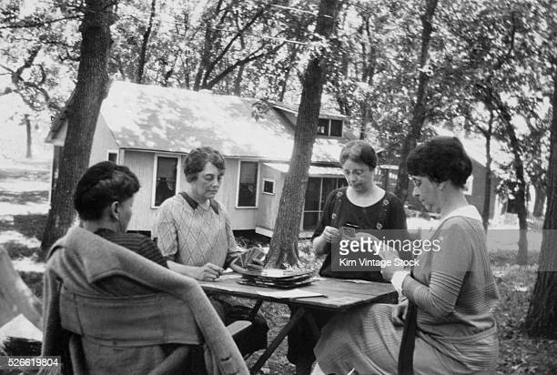 The women's card club plays in the backyard ca 1925