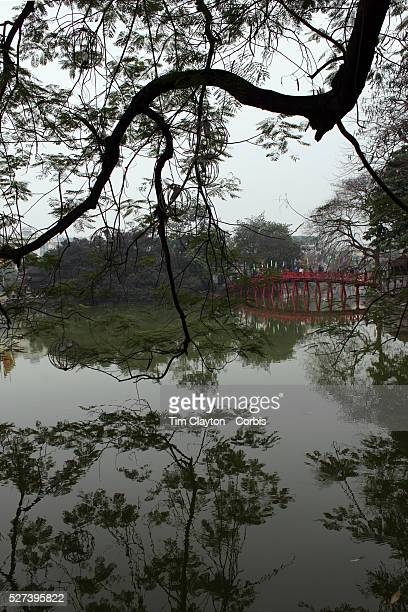 The wooden redpainted Huc Bridge also know as the Morning Sunlight Bridge and The Red Bridge which connects Jade Island to the shore of Hoan Kiem...