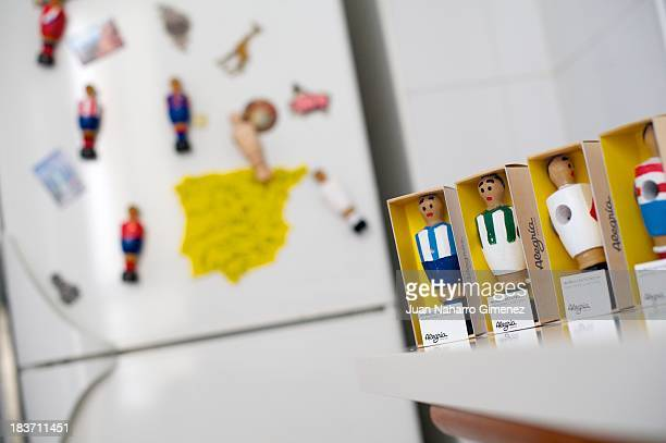 The wooden table football figures adorn the fridge as magnets at Alegria Industries' office on June 20 2013 in Madrid Spain Table football also known...