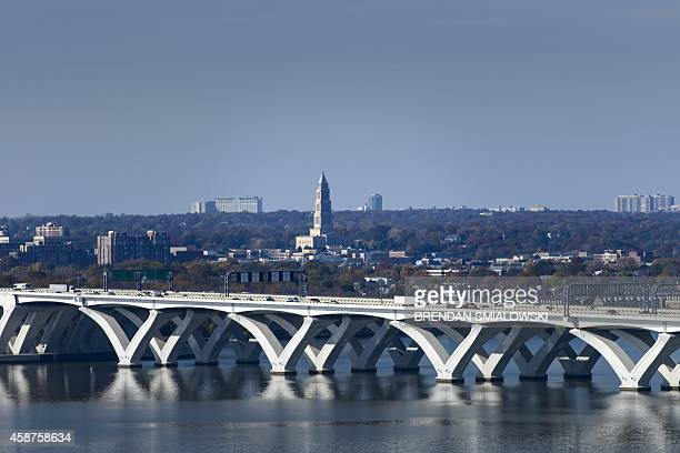 The Woodrow Wilson Memorial Bridge and the George Washington Masonic Temple in Alexandria Virginia are seen November 10 2014 from National Harbor...