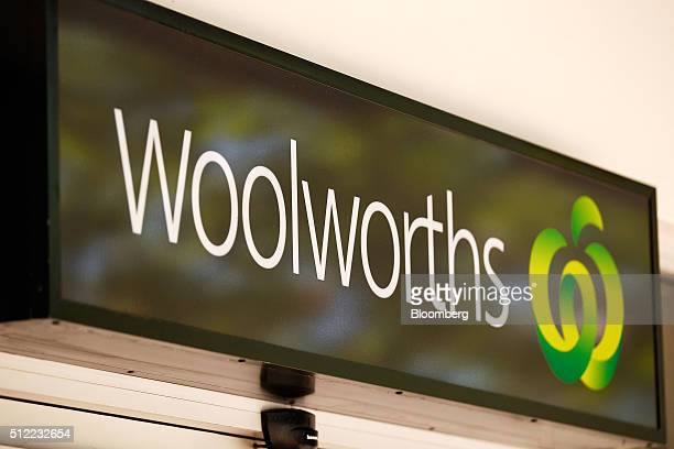 The Woolworths Ltd logo is displayed at one of the company's supermarkets in Sydney Australia on Wednesday Feb 24 2016 Woolworths Ltd Australia's...
