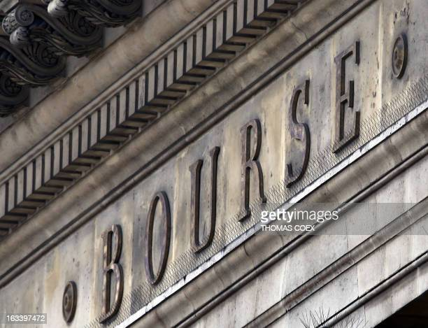 The word 'Bourse' is seen on the pediment of the Palais Brongniart the former French stock market on March 9 2013 in Paris AFP PHOTO / THOMAS COEX