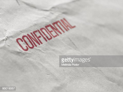 The word CONFIDENTIAL stamped on an envelope