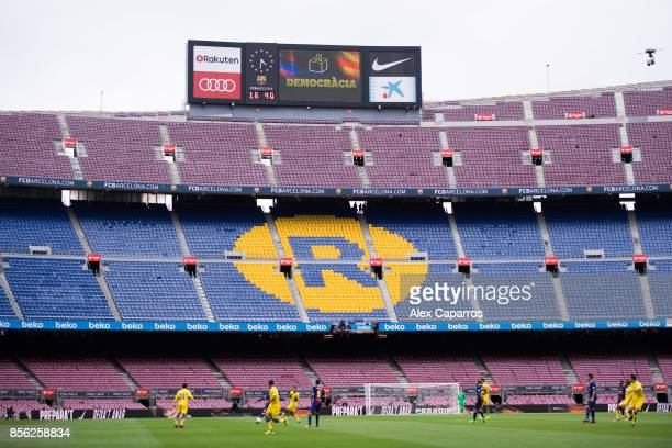 The word 'Democracia' Catalan for 'Democracy' is displayed in the stadium board during the La Liga match between Barcelona and Las Palmas at Camp Nou...