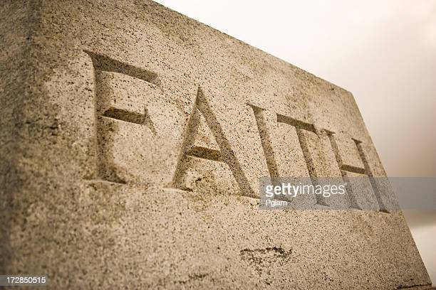 The word faith inscribed in granite