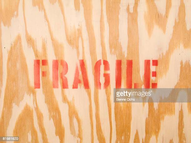 The word fragile stenciled on wood