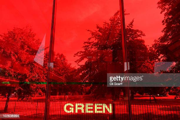 The word 'Green' is written on a red glass window of the 10th Serpentine Gallery Pavilion designed by Jean Nouvel on July 6 2010 in London England...