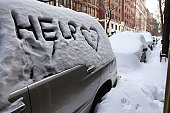 The word 'HELP' is written on the window of a car covered in snow on West 73rd Street on December 28 2010 in New York City Two days after a blizzard...