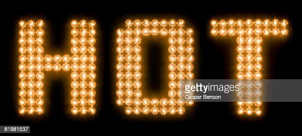 The word hot in illuminated light bulbs