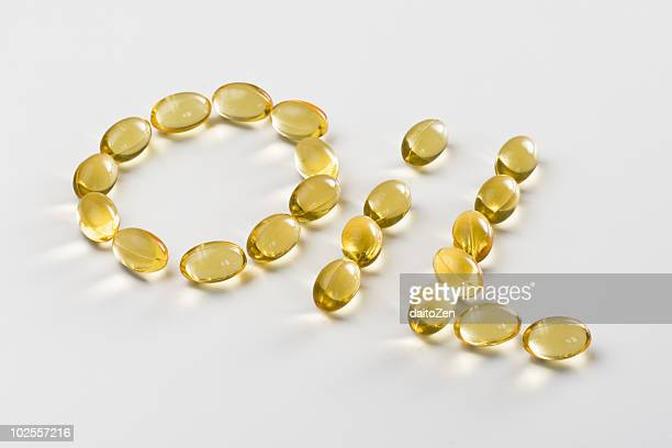 The word 'Oil' spelled with capsules