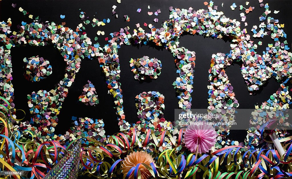 The word PARTY stenciled in confetti : Stock Photo