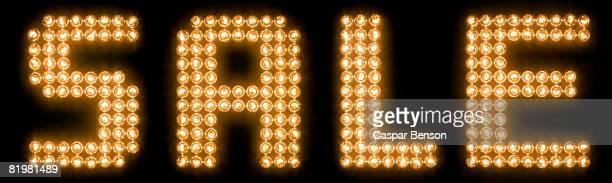 The word sale in illuminated light bulbs