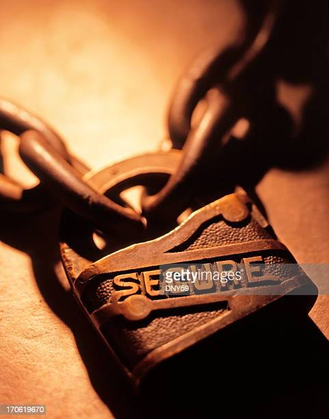 The word 'Secure' etched onto lock binding two chains together
