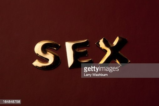 The word 'Sex' in gold lettering