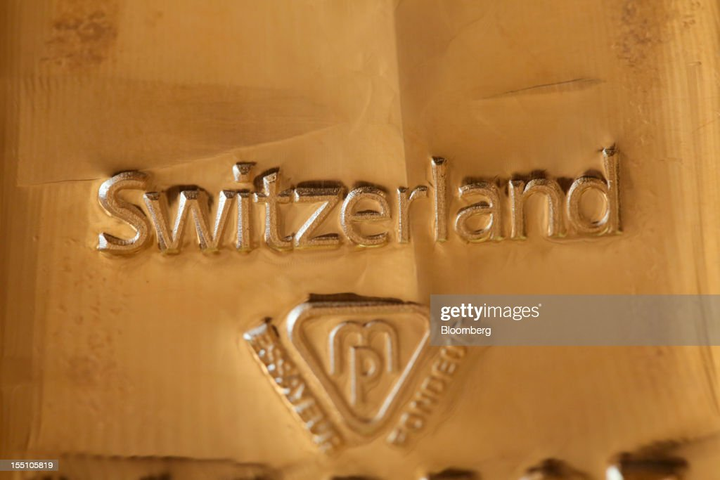 The word 'Switzerland' is seen on a one kilogram gold bar in this arranged photograph at Gold Investments Ltd. bullion dealers in London, U.K., on Thursday, Nov. 1, 2012. Gold may rise for a third straight day, as China's manufacturing expanded for the first time in three months, increasing demand prospects for commodities. Photographer: Chris Ratcliffe/Bloomberg via Getty Images