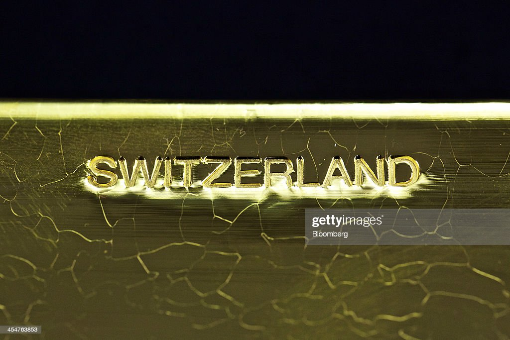 The word 'Switzerland' sits stamped on the side of a newly manufactured 400 ounce gold bar at a precious metal refinery near Mendrisio Switzerland on...