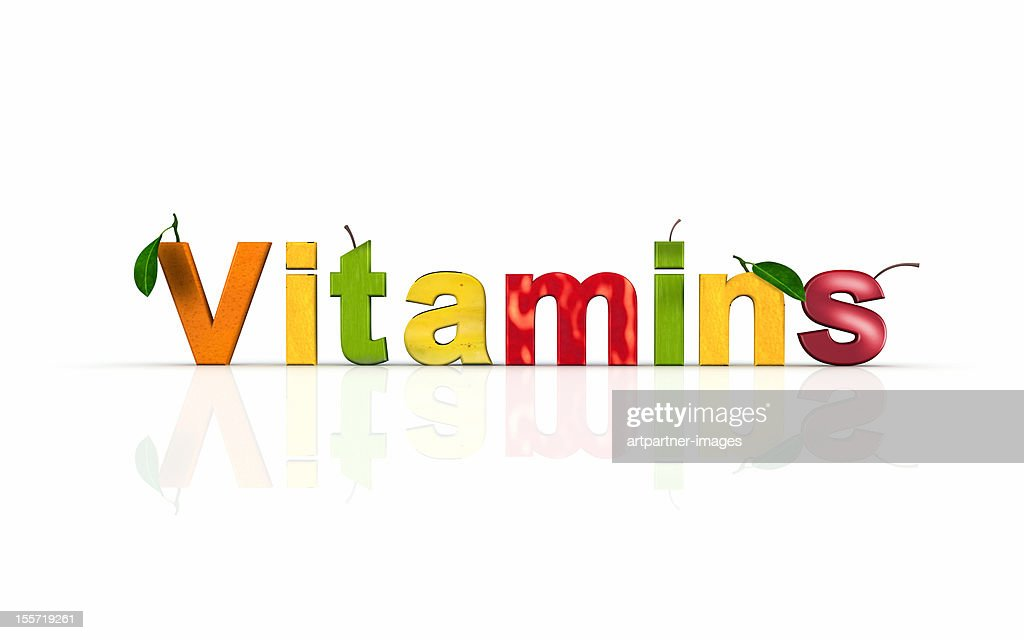 The word 'vitamins' made or cut out of fruits : Stock Photo