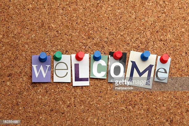 The word 'welcome' on cork Notice Board.