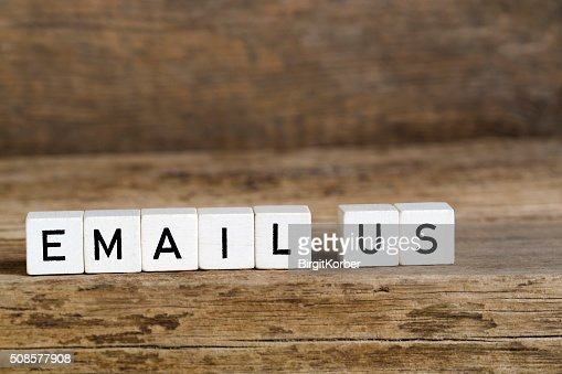 The words email us written in cubes : Stock Photo
