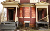 The words 'God Loves This City' are painted on the front of an abandoned home in Detroit March 23 2011 in Detroit Michigan The new census figures...