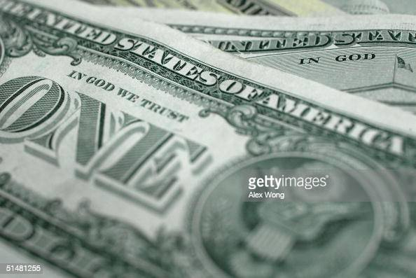 The words 'In God We Trust' are seen on US currency October 14 2004 in Washington DC Although the US constitution prohibits an official state...