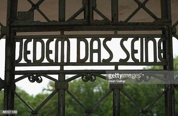 The words 'Jedem Das Seine' which in English means 'To Each His Own' stand in the metal door at the main entrance on the grounds of the former...