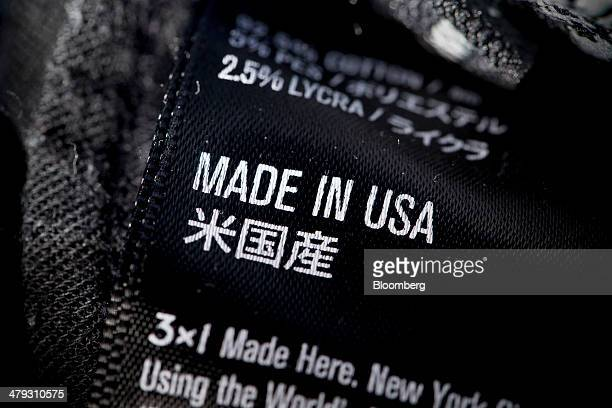 The words 'Made in USA' are displayed on the label on a pair of denim jeans manufactured by 3x1 in an arranged photograph in Hong Kong China on...
