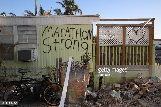 The words 'Marathon Strong' are painted on the side of a mobile home that was destroyed by hurricane Irma on September 18 2017 in Marathon Florida...
