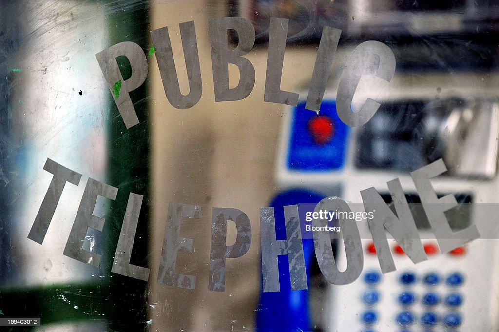 The words 'Public Telephone' are seen on the door of a fixed-line telephone booth, operated by Eircom Group, in Dublin, Ireland, on Thursday, May 23, 2013. Eircom Group, which has changed ownership six times since 1999, 'would like to be consolidators rather than consolidated' amid expected mergers and acquisitions in the Irish telecoms market, its Chief Financial Officer Richard Moat said. Photographer: Aidan Crawley/Bloomberg via Getty Images