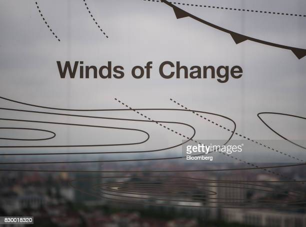 The words 'Winds of Change' sit on a window as the city skyline is seen outside the International Business Machines Corp Watson cognitive computing...