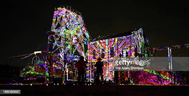 The work 'Digital Kakejiku' by digital artist Akira Hasegawa is projected to Mandakou the enterance building of former Mitsui Miike Coal Mininig site...