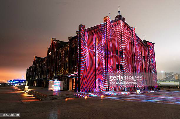 The work 'Digital Kakejiku' by digital artist Akira Hasegawa is projected to the wall of Yokohama Red Brick Wearhouse during the press preview on May...