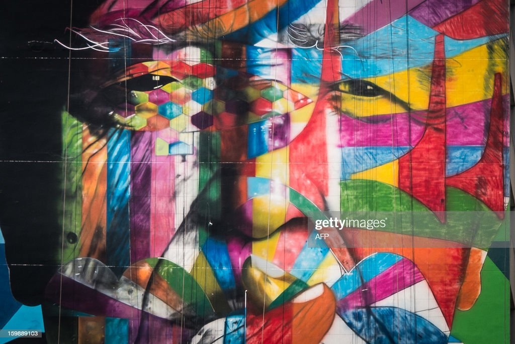 The work of Brazilian mural artist Eduardo Kobra is seen on the side of a 56-meter high building, portraying Brazilian architect Oscar Niemeyer who passed away last December at the age of 104, along Paulista avenue in Sao Paulo, Brazil on January 22, 2013. Internationaly renown Kobra started to negotiate to paint the building 5 years ago and now, financially supported by the building management, Kobra paints voluntarily ahead of the commemoration of the city's 459th anniversary next January 25. AFP PHOTO/Yasuyoshi CHIBA