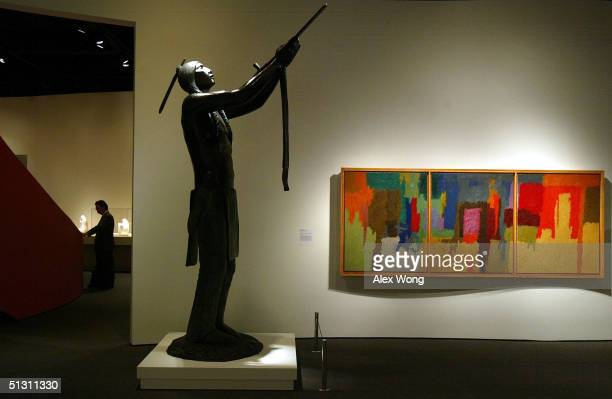 The work of two Native American artists bronze sculpture 'May We Have Peace' by Allan Houser and oil painting 'Passage' by George Morrison are on...