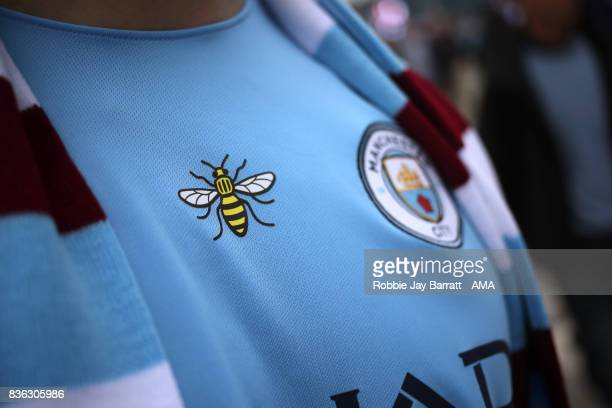 The Worker Bee iconic symbol of Manchester on the shirt of a fan during the Premier League match between Manchester City and Everton at Etihad...