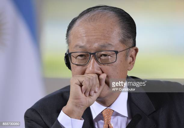 The World Bank President Jim Yong Kim talks to the media next to Argentina's President Mauricio Macri during a press conference after a working...