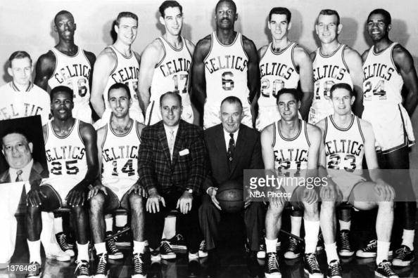 The World Champions of basketball Boston Celtics pose for a team portrait seated K C Jones Bob Cousy coach Red Auerbach President Walter A Brown Bill...