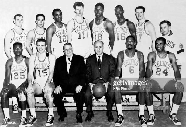 The World Champions of basketball Boston Celtics pose for a team portrait seated KC Jones Tom Heinsohn President Louis Pieri Head Coach Red Auerbach...