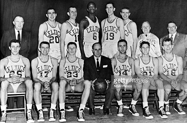 The World Champions of basketball Boston Celtics pose for a team portrait front row Lou Tsioropoulos Andy Phillip Frank Ramsey Head Coach Red...