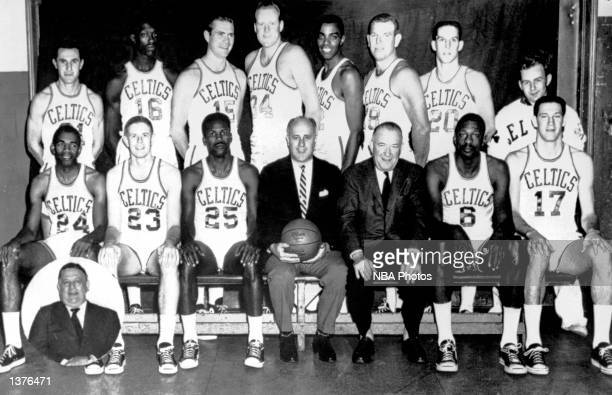 The World Champions of basketball Boston Celtics pose for a team portrait seated Sam Jones Fran Ramsey K C Jones Head Coach Red Auerbach President...