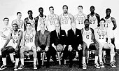 The World Champions of basketball Boston Celtics pose for a team portrait front row Sam Jones Larry Siegfried G M Red Auerbach Chairman of Board...